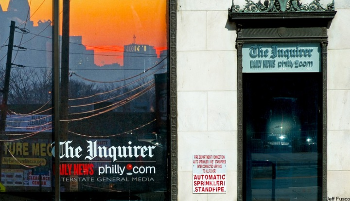 The-inquirer-building-with-sunset-reflecting